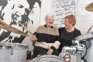 The beat goes on - Arts Council of Northern Ireland funding announcement of £160,000 music to the ears for 20 groups using the arts to give a voice to older people May Rodgers, (80) from Bruce House residential home for people living with Dementia in North Belfast, refining her beat at the 'Oh Yeah' Centre in Belfast alongside Fiona McGettigan, Activities Co-ordinator from the Belfast Trust. The Oh Yeah Centre is one of 20 successful arts and community groups to share in £160,000 funding from The Arts Council National Lottery and the Health Promotion Agency to deliver the Arts & Older People Programme this year. Photo by Simon Graham/Harrison Photography